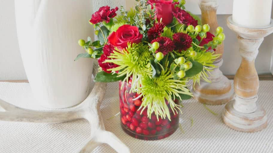 Combine cranberries and your favorite holiday colors to make a stunning holiday bouquet as a gift or décor for your home. (Photo by Taryn Whiteaker/Design, Dining and Diapers)