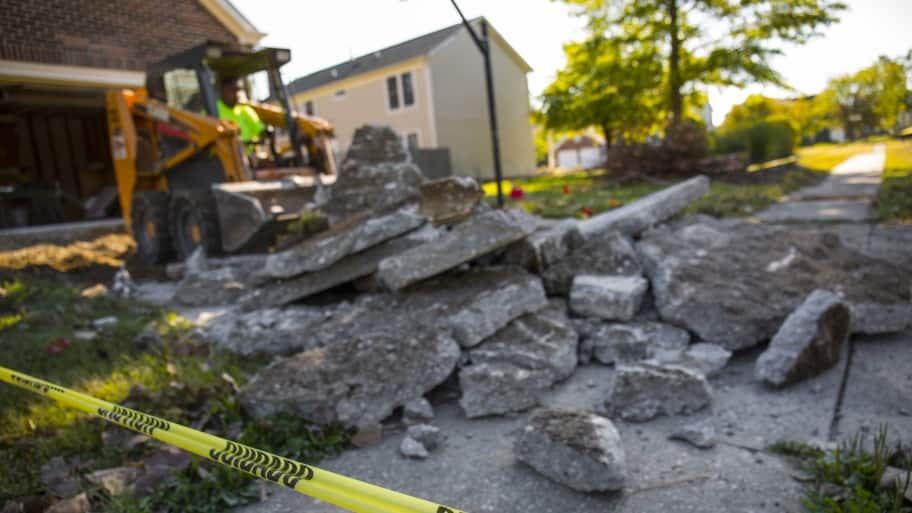 worker demolishing concrete