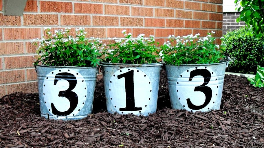 house numbers on metal buckets