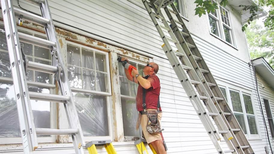 Worker installing windows in a home