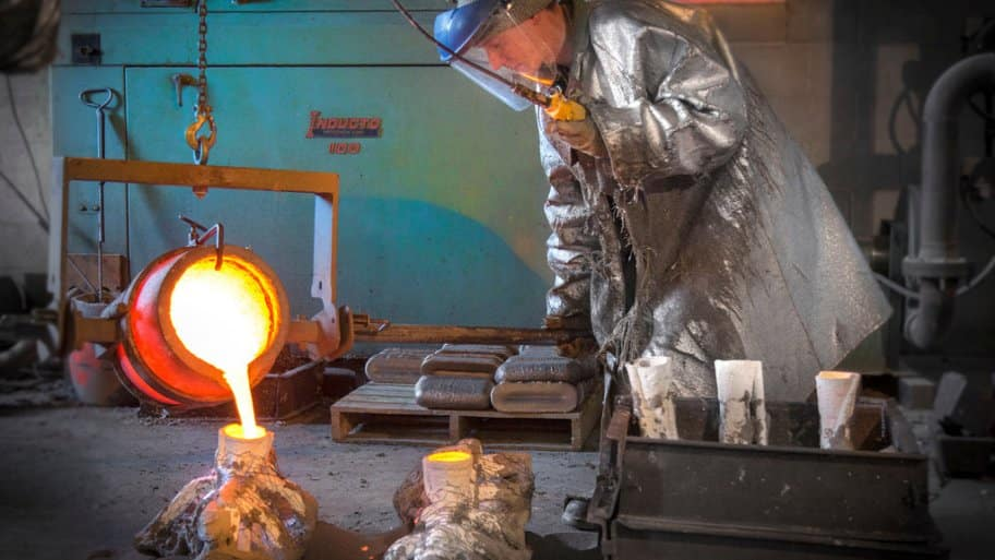 Ryan Feeney of Indy Art Forge pours the mold for his fireman statue's shoes