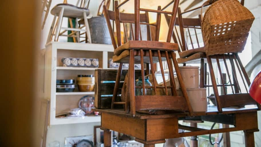 some wooden antique chairs stacked on a table. DIY Tips to Refinish Antique Furniture   Angie s List