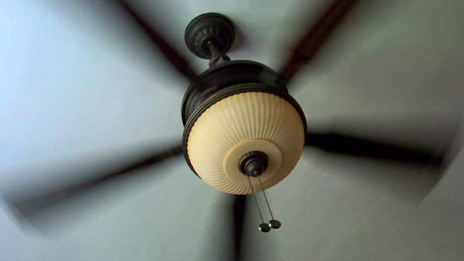 A running ceiling fan with light