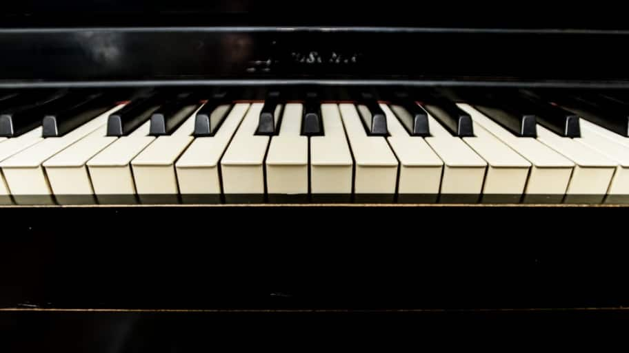 keys on a black piano
