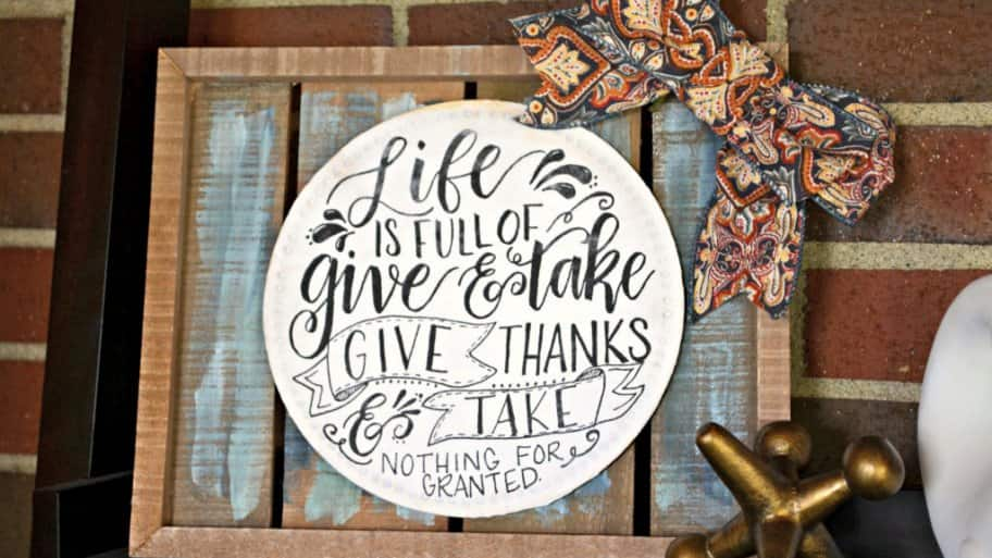 You can make a stunning Thanksgiving sign that will look great throughout the fall and can be customized with paint and ribbons. (Photo by Abbey DeHart/The Cards We Drew)