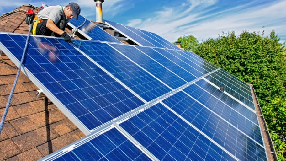 solar panels being installed on a roof