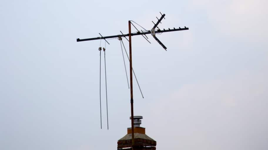 a digital antenna on top of a house