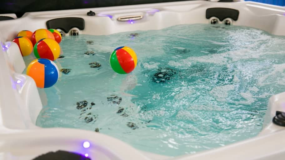 a hot tub with some balls