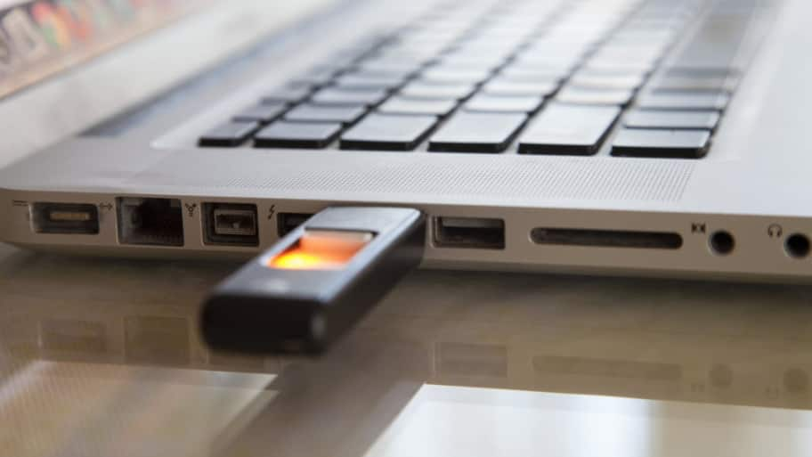 A laptop computer with a flash drive plugged in