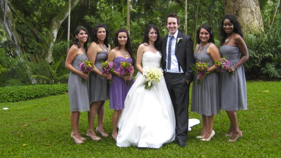a bride and groom with bridesmaids