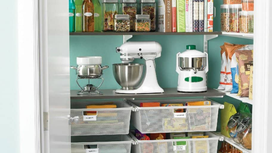 Organized Kitchen Pantry With Baskets And Shelves,