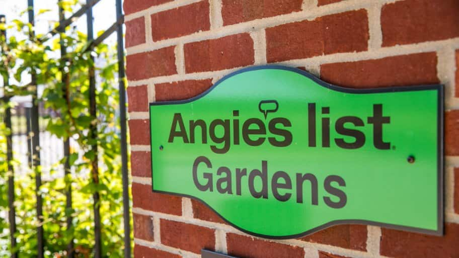 Green Angie's List Gardens sign on brick wall at Indiana State Fair