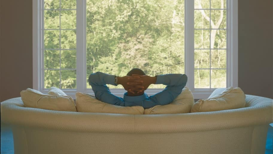 man on couch, window, relaxing