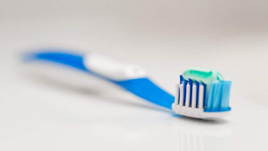 a toothbrush with toothpaste on it