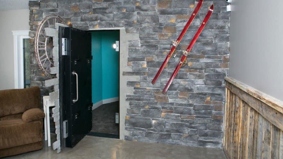 hidden door in stone-faced wall
