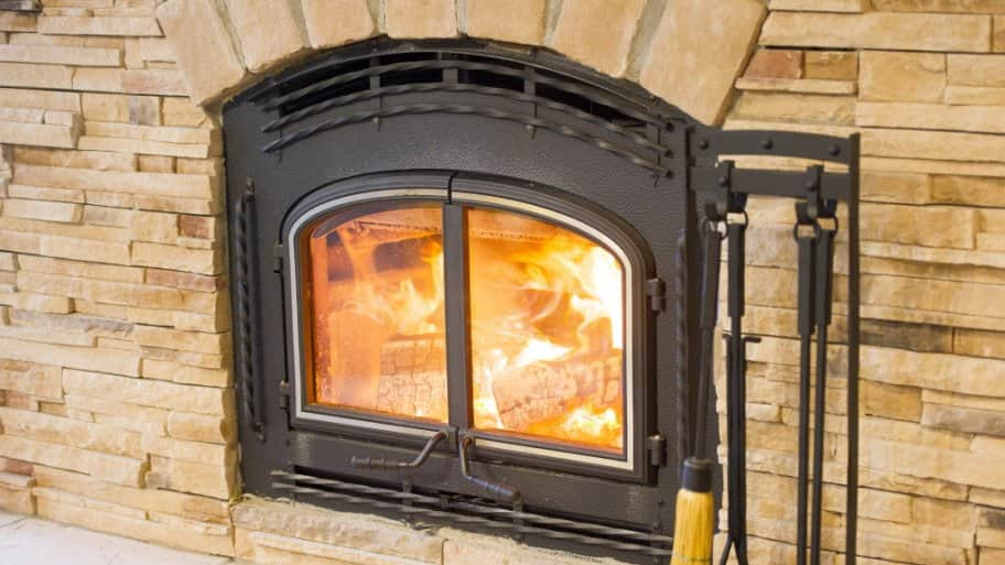 Fireplace tools by fireplace glass door