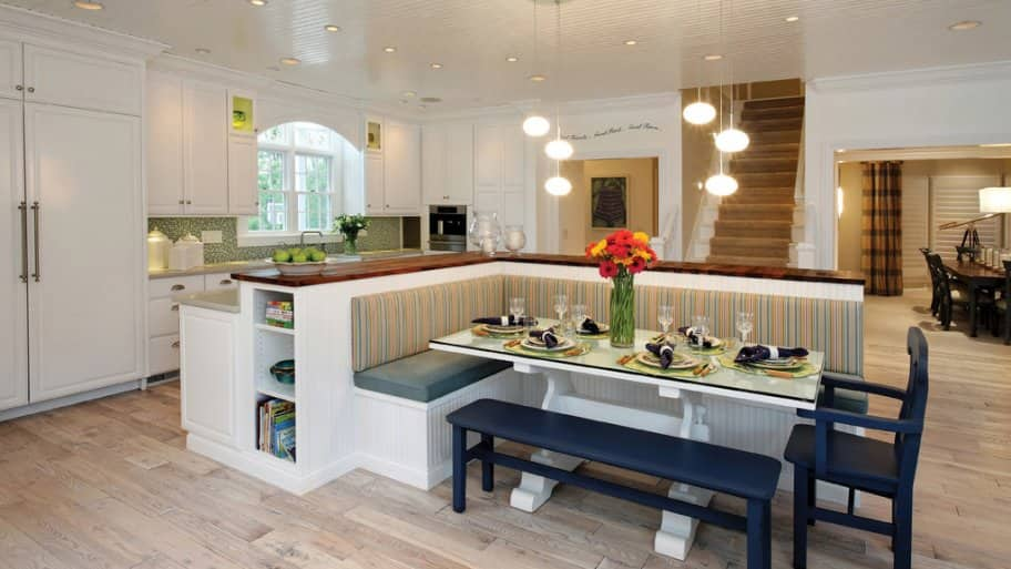 Home with recessed and hanging lights over a kitchen bar