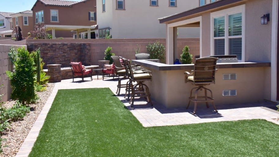 An Angie's List member turned his backyard into a relaxing retreat with an outdoor kitchen and fire pit. (Photo by Reuben P.)