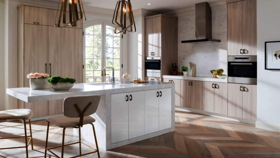 A Kitchen Island With Cabinets And Eating E