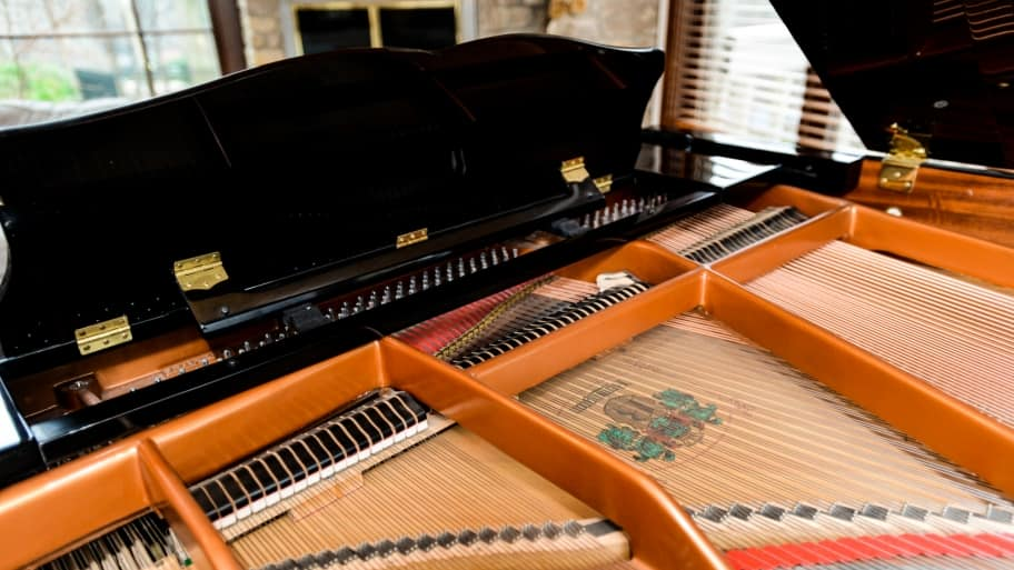 the inner workings of a baby grand piano