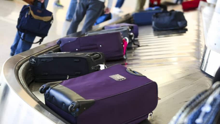 suitcases on an airport luggage carousel