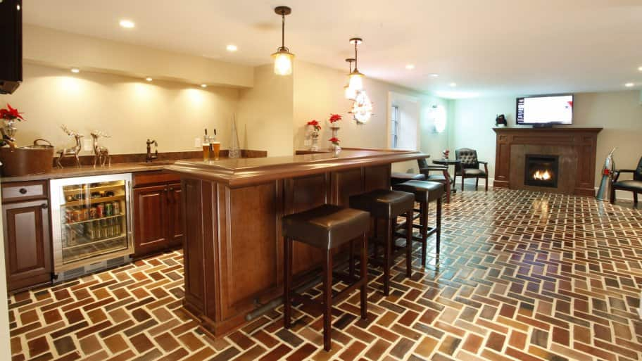 basement with bar and fireplace
