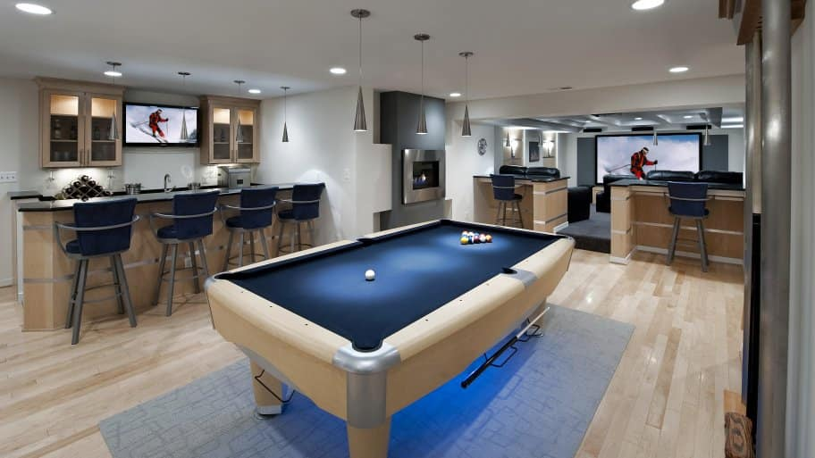 finished basement with pool table and wet bar