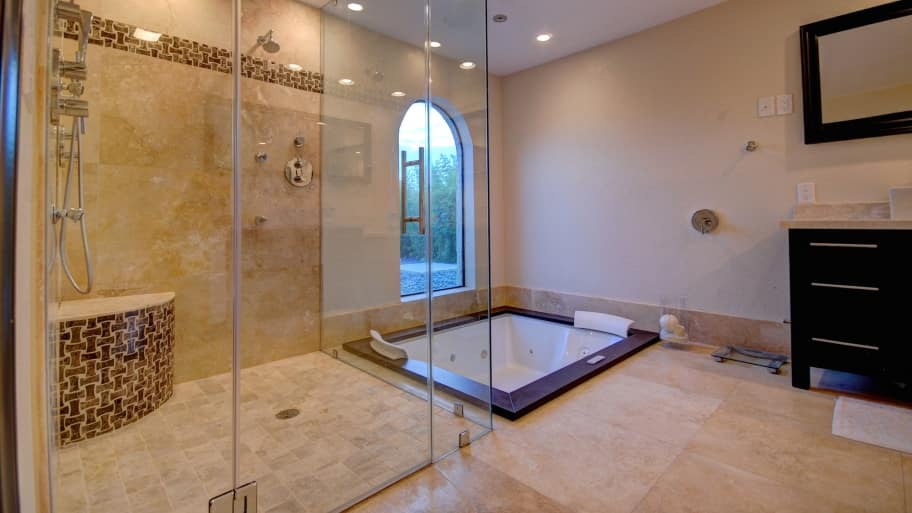 remodeled bathroom with walk-in shower and whirlpool tub