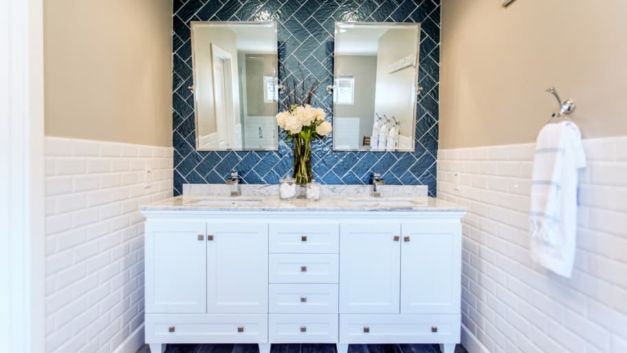 bathroom remodel and white sink vanity with subway tile