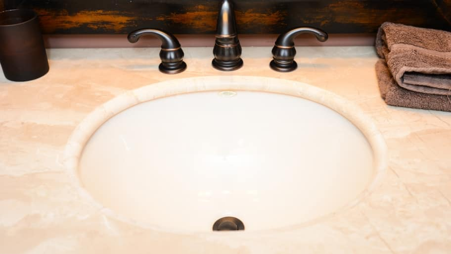 bathroom sink countertop brushed bronze faucet. Bathroom Countertop Options Abound   Angie s List