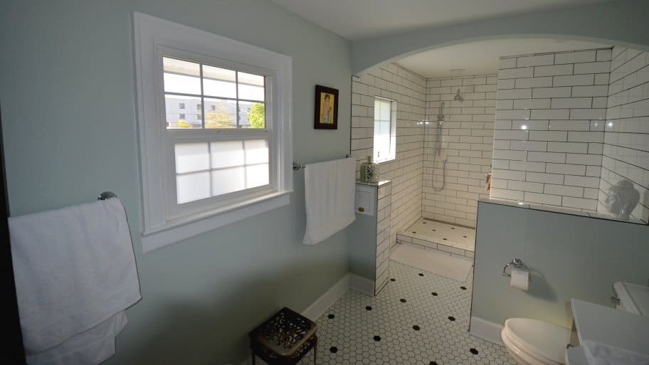 bathroom remodel with white subway tile in shower