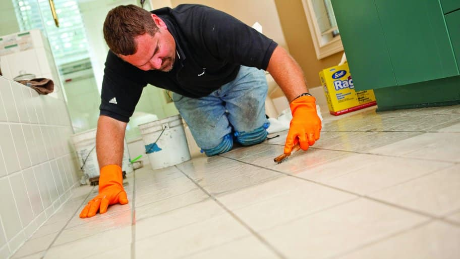 Man regrouting bathroom tile. How Does Regrouting Tile Work    Angie  39 s List