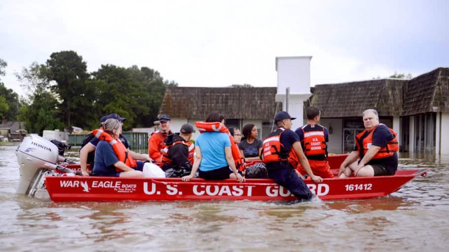 Coast Guardsmen rescue stranded residents from high water during severe flooding around Baton Rouge, La