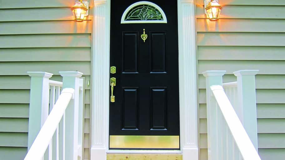 Superbe Black Exterior Door With Gold Hardware And Kick Plate