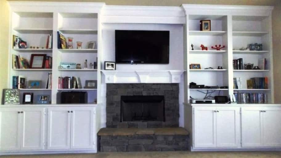 custom built-in bookshelves around living room fireplace