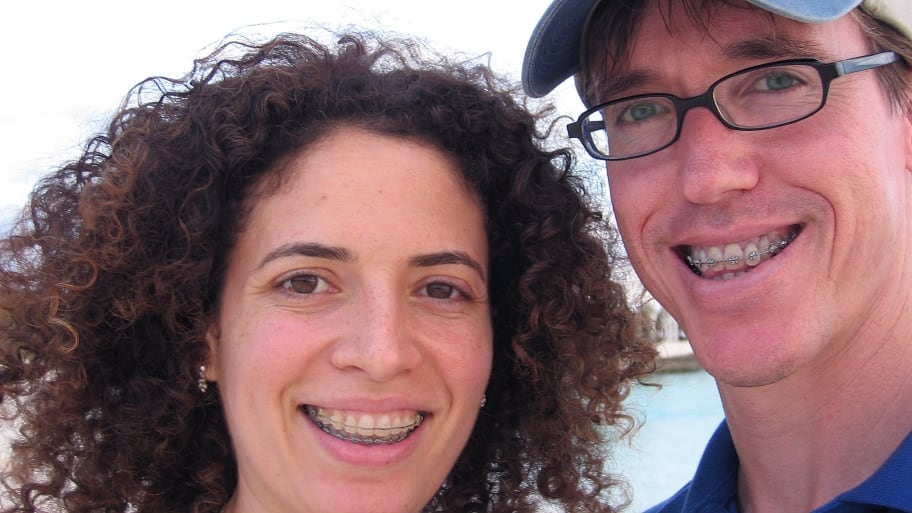 couple smiling while wearing braces