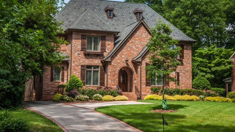 Brick home with asphalt shingles