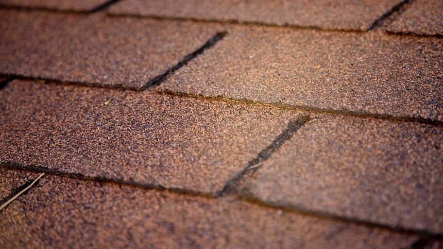 brown asphalt shingles up close