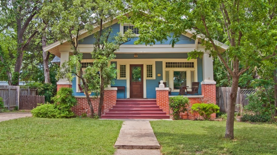 Craftsman bungalow house with trees