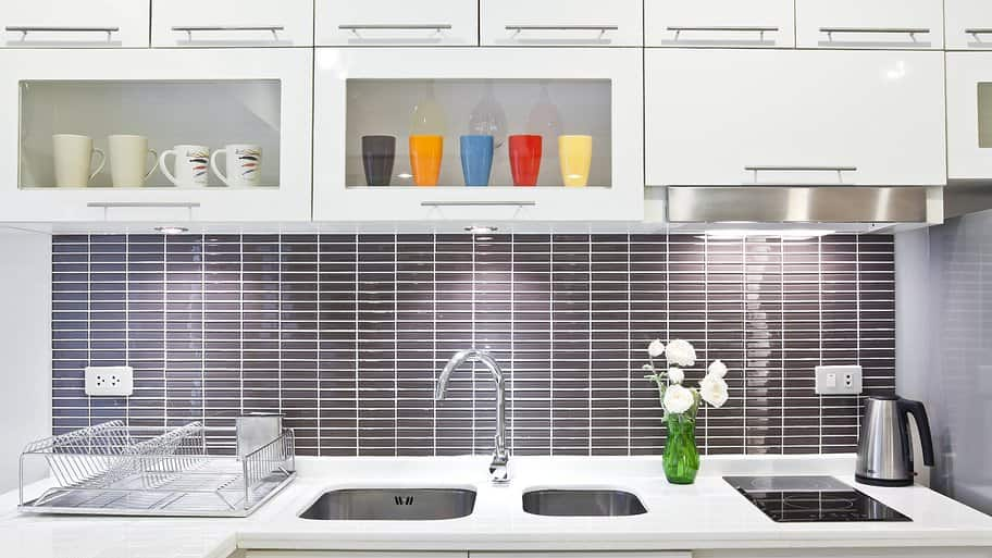 Under lighting for cabinets Wireless Under Cabinet Lighting In White Kitchen With Gray Subway Tile Backsplash Angies List Lighting Options For Inside And Under Your Kitchen Cabinets