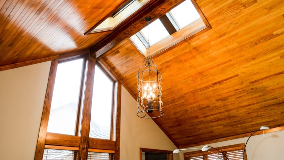 vaulted stained wood ceiling and window frame built by carpenter