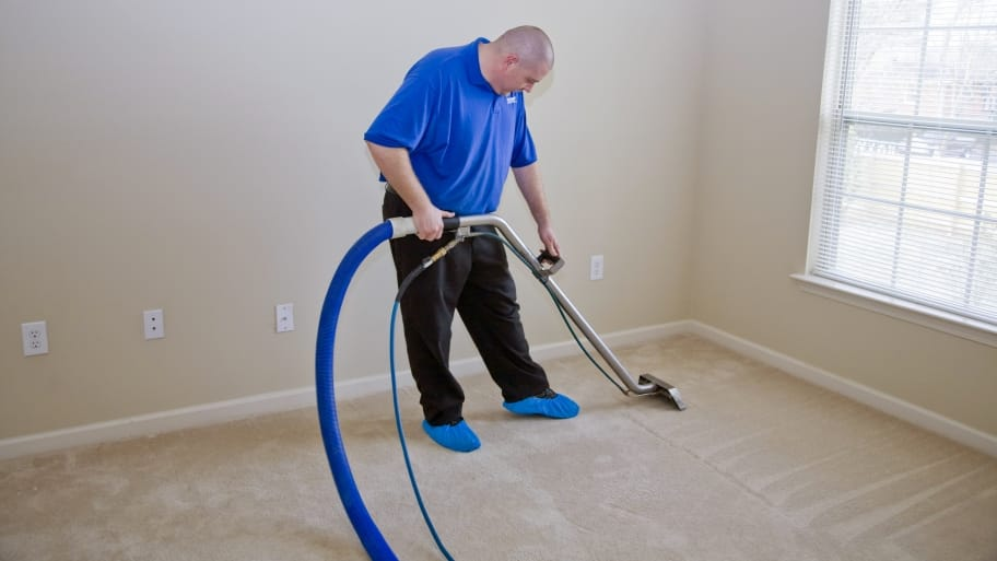 technician cleaning carpet
