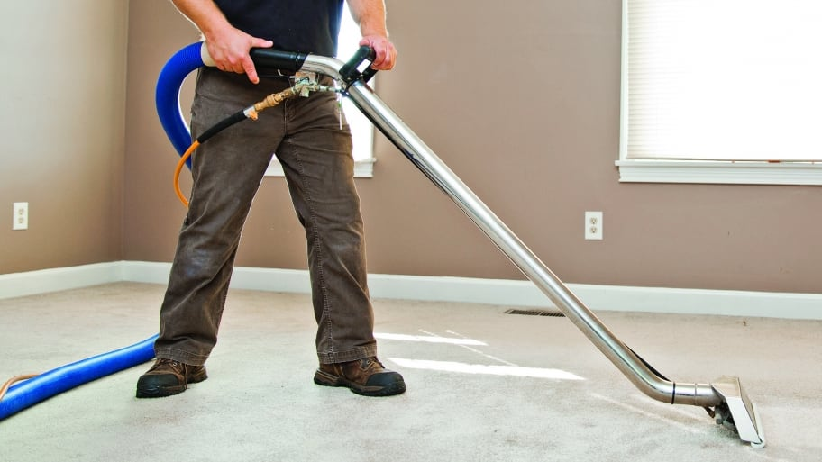 man cleaning carpet