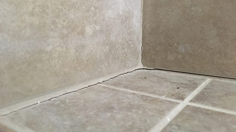 Avoid Cracked Grout: Caulk Tile Shower Corners