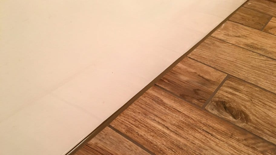 Avoid Cracked Grout Caulk Tile Shower Corners Angies List - Can i caulk over grout