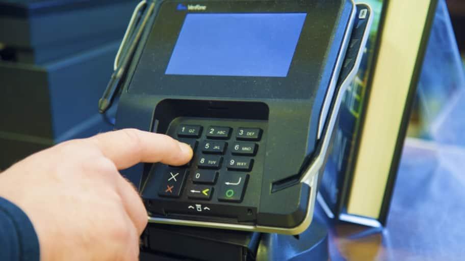 man using credit card machine