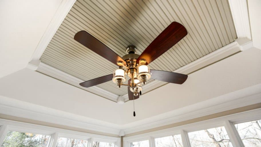 ceiling fan with lights, mounted inside a house