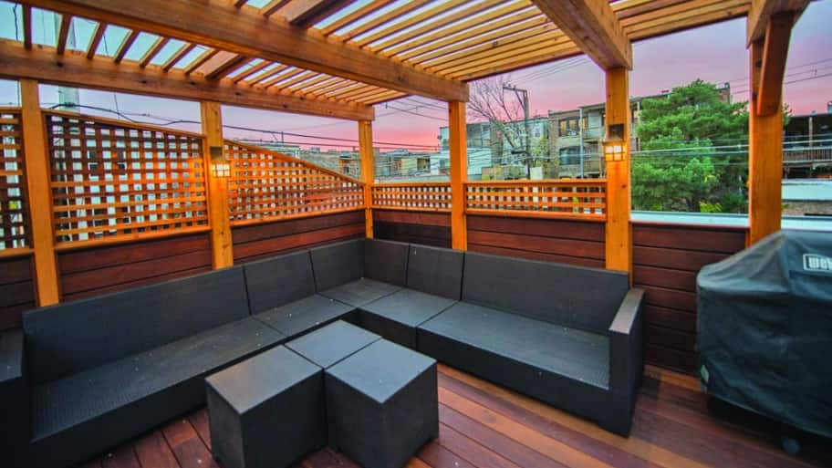 stained deck with lattice walls pergola and sectional outdoor couch