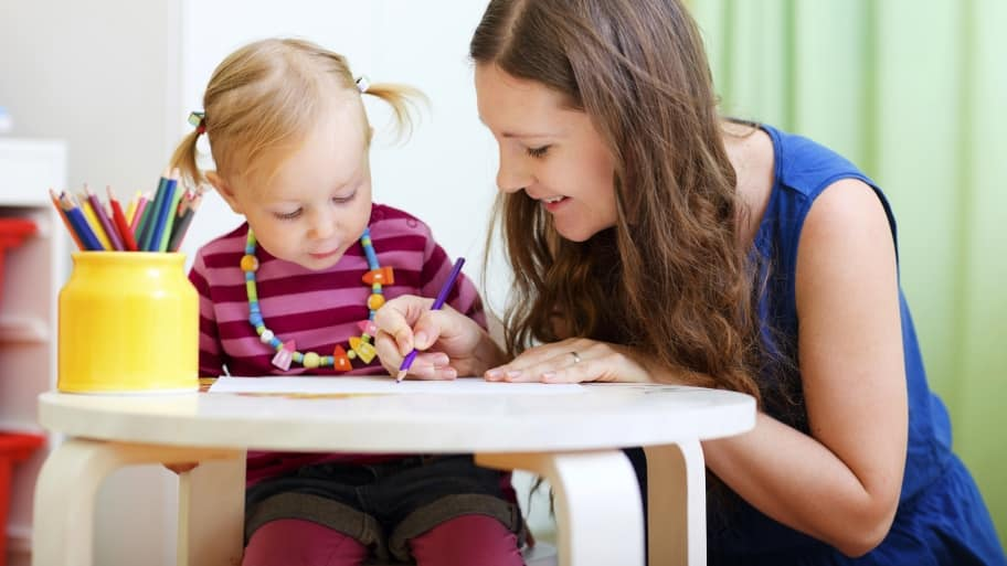 child care provider drawing with a toddler