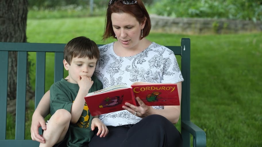 woman reads children's book to her son (Photo by Steve C. Mitchell)